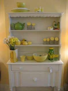 makes me want to paint my buffet & hutch white :D and love love love all the yellow!  LOVE This!