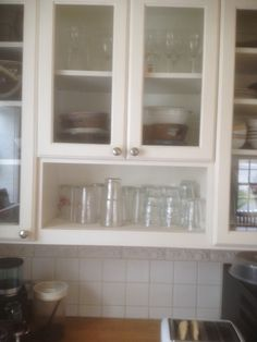 """10"""" Hight open shelf in cabinet for glasses so kids and company can easily reach them and get their own drinks."""