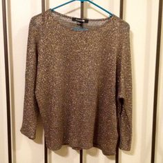 NWOT top from Forever 21! This is a beautiful shimmery top! I bought it and never found a place to wear it to. It's never been worn, NWOT. Forever 21 Tops Blouses