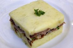 Parmentier de confit de canard http://cuisine.journaldesfemmes.com/recette/355779-parmentier-de-confit-de-canard#addToBook