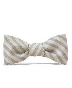 This is a cool bow tie to go with those boutonnieres. I think it's diff. to have the bow tie with out the suit.  Interesting.