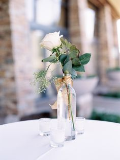 Simple yet elegant centerpiece | Green leaves and a white rose with gold ribbon | Trilogy at Vistancia Weddings | Arizona Wedding Venue | www.weddingsatvistancia.com | Rachel Solomon Photography