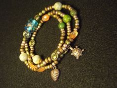 This Wrap showcases Wood and Glass Seed beads along with Agate and Glass accent beads. Adorned with bronze plated Pewter Sea Turtle and Leaf charms.