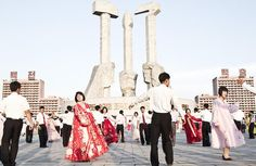 Another face of North Korea: Mass dance in front of the Monument to Party Foundation - Pyongyang