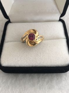 A personal favorite from my Etsy shop https://www.etsy.com/listing/501898128/14k-solid-gold-rhodalite-garnet-23ct