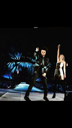 The Weeknd on stage with Taylor Swift.
