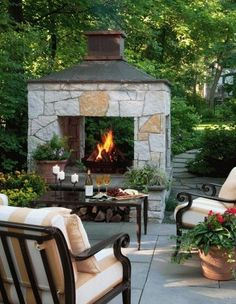 I like that it's open to the back for another seating area...42 Inviting Fireplace Designs for Your Backyard