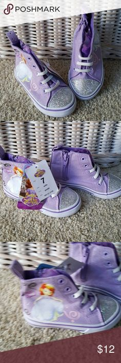 Sofia the First Mid Top Sneaker Size 7 NEW Your little girl will love these mid top sneakers with Sofia the First. Size 7. Side zippers, elastic prelaced. Inside elastic to hug the foot. Sparkle toes. From a smoke-free home. Disney Shoes Sneakers