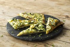Spring Veggie Flatbread with Basil Pesto & Lemon. Lemon, squash, and basil pesto are a flavor combination we just couldn't keep to ourselves. Crispy flatbread and gooey mozzarella don't hurt the equation, either! A sprinkle of floral lemon zest on top wakes up the palate and reminds us that Spring is finally here!