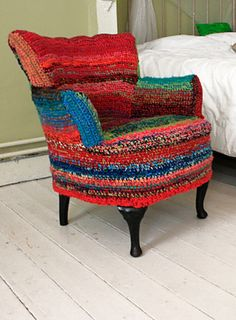 Chair slipcovered in crochet with random scraps of yarn, by Ponnekeblom, posted on Ravelry. What a fresh revival for a tired and somewhat dowdy chair!