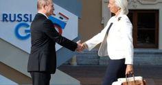 Vladimir Putin ja IMF:n pääjohtaja Christine Lagarde.