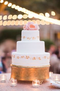 white wedding cake with gold ivy detail.  A Dreamy Blush Wedding at The Club at the Strand in Naples, FL https://www.thecelebrationsociety.com/weddings/a-dreamy-blush-wedding-at-the-club-at-the-strand-in-naples-fl/