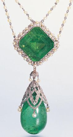 A Belle Epoque emerald, diamond and seed pearl necklace, French, circa 1905. Set with a cut-cornered, square-cut emerald within a millegrain frame of seed pearls and single-cut diamonds, terminating in a detachable pendant with a large drop-shaped cabochon emerald below an openwork lattice of diamond and seed pearl garland motifs, the whole suspended from a seed pearl chain with diamond foliate spacers, with maker's mark: MR and French assay mark. #BelleÉpoque #necklace