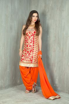 Raw silk kurta with patiala embellished with leather applique work