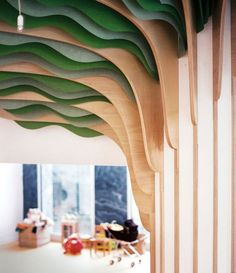 studio millimètre installs six meter high tree in paris nursery the monumental interior element is made of plywood boards, with leaves composed of suspended, cut paper sheets. Kindergarten Architecture, Kindergarten Interior, Kindergarten Design, Architecture Restaurant, Interior Architecture, Design D'espace Public, Bar Bistro, Paris Nursery, Nursery Design