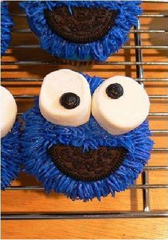 Cookie Monster Cupcakes!   Blue Icing, Marshmallows & Raisins for the eyes and half of an oreo for the mouth