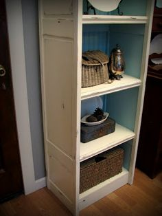 Bi-fold doors made into bookcase - love this idea, bi-fold doors are very easy to come by! I like the colors/finish too,and beadboard in the back - posted by MyRepurposedLife™ guest from Blue Roof Cabin - #upcycle #repurpose #DIY #furniture #shelf #bifolddoor - tå√
