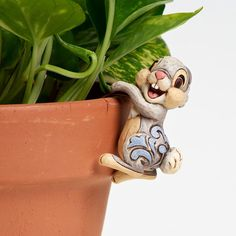 Disney Traditions - Figura con forma de Tambor para colgar de maceta: Amazon.es: Hogar
