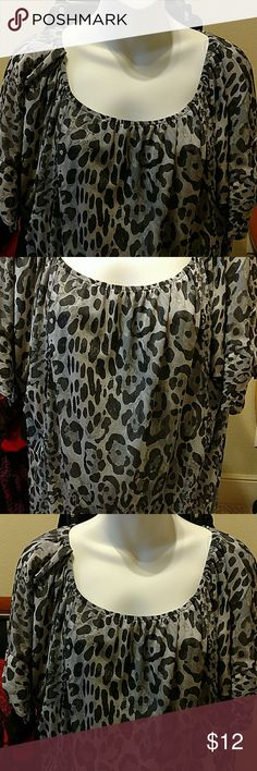 Blouse. I-N-C brand Animal print blouse. I-N-C brand/ International Concepts. Nice sleeve accent, see pic. Size is XL. I'm a size small so I wore as oversized blouse with leggings and heels/boots. Great look. INC International Concepts Tops Blouses