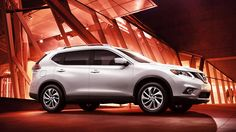 Nissan Rogue® SL AWD shown in Moonlight White with optional equipment