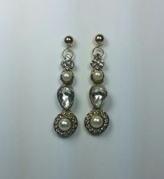 Lovely dangling crystal and pearl earrings from Tessharrissdesigns.com