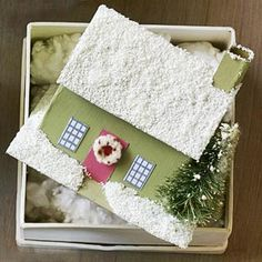Replicate your home or create an entire village with these ornamental abodes that are decked out for the holidays.