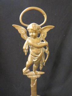 Brass Figural Doorstop of Cherub : Lot 224