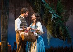 """Tommy Albright (Kevin Earley) and Fiona MacLaren (Jennie Sophia) fall in love across the centuries in Goodman Theatre's revival of the Lerner & Loewe musical """"Brigadoon,"""" directed and choreographed by Rachel Rockwell."""