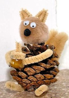 pinecone squirrel -- make with pinecone, pipecleaners and pom poms. Also, use tacky glue for a quick stick.