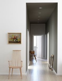 Stay minimal If your hall is super-skinny, stick to the basics, as in this pared-back space. Wooden flooring and recessed ceiling spots are neat and unobtrusive, while a lack of fussy picture rails or high skirting boards contributes to the impression of a calm, ordered home. Finally, a vintage painting and wooden chairs add a dab of character to stop it feeling bland.