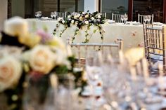 Wedding in Andalucia by caprichia.com Weddings & Occasions. Table setup and florals in a creamy & antique silver/gold palette with romantic touches.Photography by Anna Gazda.