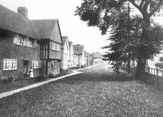 Well Hall Road, Progress Estate, Eltham, 1915. Well Hall Road on the Progress Estate was built by the government in 1915 for Woolwich Arsenal workers. The architect was Sir Frank Baines.This view shows the large green in front of the houses, with very little in the way of private front gardens.