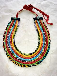 African and Batik Fabric Colorful Cord Necklace with turquoise and coral chip beads by paintedthreads2