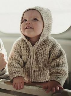 Free Knitting Pattern for Two Row Repeat Baby Hoodie - This zippered cardigan with hood features a two row repeat textured stitch and minimal seaming just to attach the sleeves and hood to the body. Sizes 6 months, 12 months, 18 months and 2 years. Designed by Jeannette Murphy