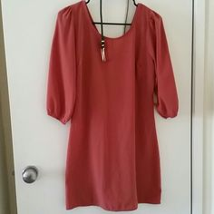 Cute dress with belt Silky material dress, size small, zipper v back, color is like a burned orangish came with a forest green belt. Dresses Mini