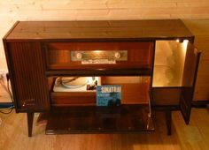 The return of the Radiogram.  Lit up like a Christmas tree.  Late fifties, early sixties vintage valve Blue Spot radio and Garrard Record Deck.