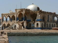 """Ruins of the winter Imperial Palace of Haile Selassie in Massawa, Eritrea, an ancient Red Sea port, which was previously part of the Axumite Kingdom. The palace was constructed in 1872. It suffered damage during the war and continues to do so now with the passage of time. US Embassy staffer Margery Benson says, """"The view of Haile Selassie is mixed, as would be the case of any leaders. The UN forced the notion of Eritrea & Ethiopia being confederated after WW2."""""""