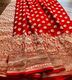Embrace your femininity with this khaddi georgette banarasi red saree ! The place of the red saree in ethnic wear is iconic.