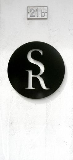 Ligature-Logo with the capitel letters S and R mounted on an office building in Colombier (Neuchâtel)