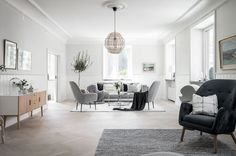 Scandinavian Living Room by INTRO INRED