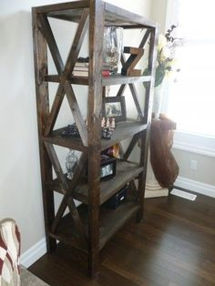 """Rustic Bookcase - This project was to add some storage in our living room on each side of our entertainment console. I customized the dimensions of the sofa table to fit behind the back of our 12' wide couch: 8' wide x 12"""" deep x 28.5"""" tall. I Added the steel angles and cast iron malleable washers and lag screws to dress up the table a bit. I had also soaked the angles, screws and washers in a vinegar/salt solution to give it that authentic rusti"""