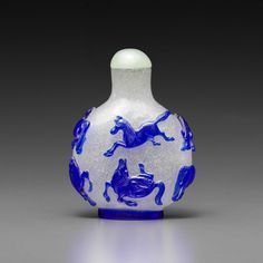 A BLUE-OVERLAY BUBBLE-SUFFUSED GLASS BOTTLE 19th Century