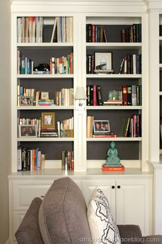 Backing a bookcase with grey grasscloth -  A Thoughtful Place