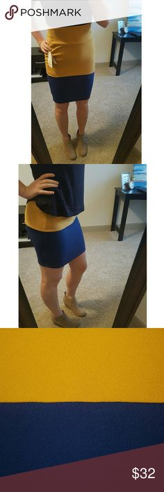 Lularoe Cassie Pencil Skirt XS Beautiful textured gold and navy pencil skirt. Wear it high or low to change up the look! 95% Polyester, 5% spandex.   For sizing reference I am a size four and the xs fits perfectly.   Please note I am not a professional photographer, I try to make the pictures look as accurate as possible but the color may appear slightly different in person. LuLaRoe Skirts Pencil