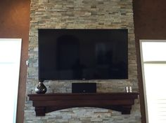 Beautiful natural stone veneer surrounding gas fireplace.