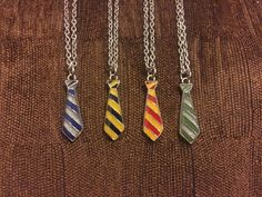 Show your Hogwarts house pride with these Harry Potter-inspired Hogwarts House Ties Necklace! Choose one for yourself or get two so you and your best friend can show that Gryffindors and Slytherins can be best friends. Or you can get all four ties and represent Hogwarts!  Note: Selecting All Four Houses will give you all four ties on a single necklace.