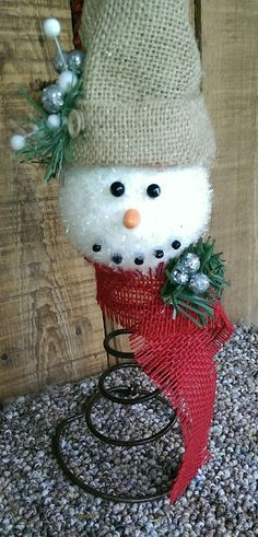 Rustic Christmas Bed Spring Snowman Decor {I like the sparkly head and burlap hat and scarf, so cute}
