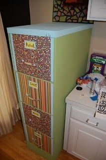 Refinish an old filing cabinet using paint and scrapbook paper. Very Cute!!    Leslie @ Jack of Trades!