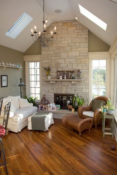 This is what I want in our family room...windows added to either side of the fireplace and stacked stone on the fireplace to the ceiling.