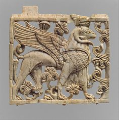 ca 9th-8th cent. BCE. Neo-Assyrian Ivory plaque with ram-headed sphinx,  Nimrud. Mesopotamia.